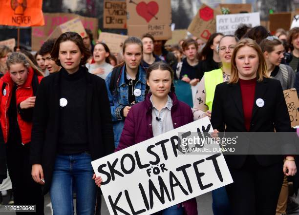 Swedish 16yearsold climate activist Greta Thunberg takes part in a march for the environment and the climate organised by students in Brussels on...