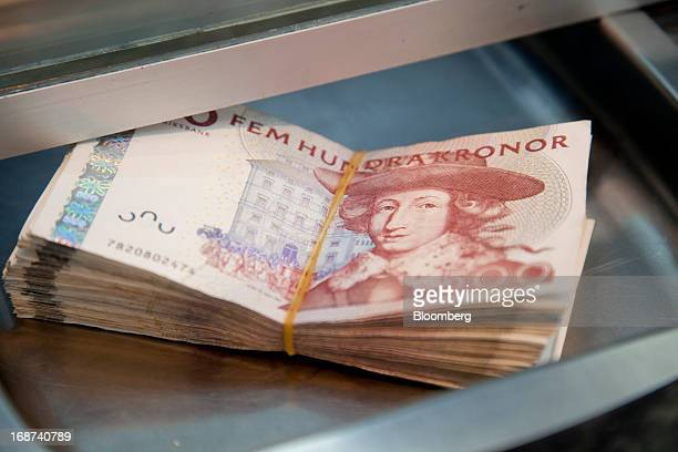 Swedish 500 kronor notes are seen in this arranged photograph inside a currency exchange in Malmo, Sweden, on Tuesday, May 14, 2013. Sweden's krona...