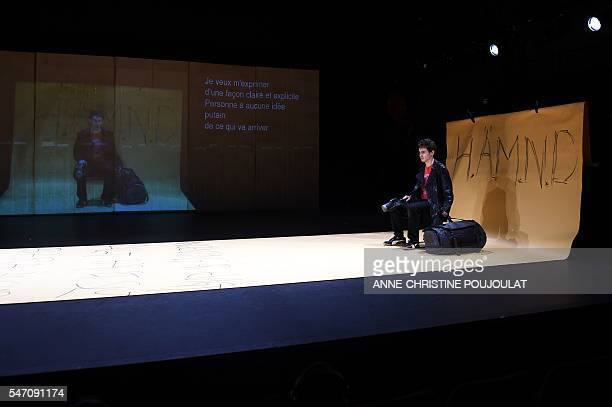 Swedish actor David Fukamachi Regnfors performs during a rehearsal of the play '20 November' written by Lars Noren and directed by Sofia Jupither on...