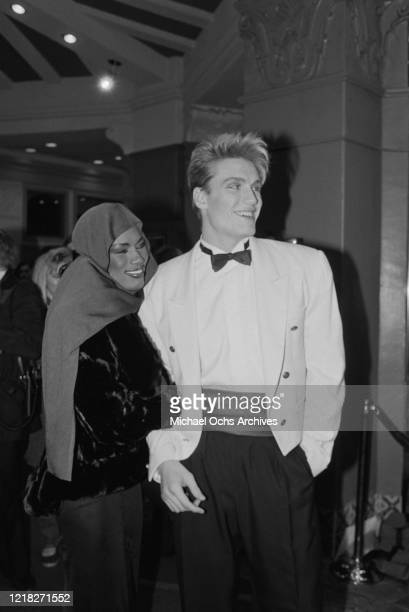 Swedish actor Dolph Lundgren and his partner, Jamaican singer Grace Jones at the premiere of the film 'Rocky IV' at the Westwood Village Theatre in...