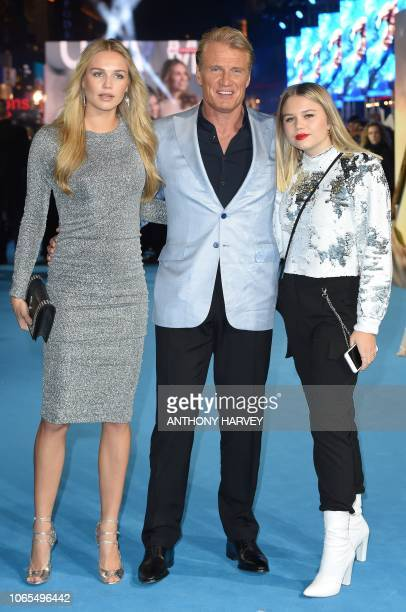 Swedish actor Dolph Lundgren Ida Lundgren and Greta Lundgren pose upon arrival to attend the World Premiere of the film Aquaman in London on November...
