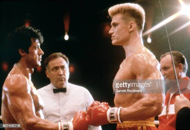 Swedish actor Dolph Lundgren with American actor director and screenwriter Sylvester Stallone on the set of his movie Rocky IV