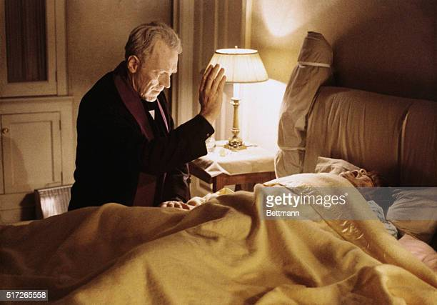 Swedish actor Max von Sydow performs a exorcism in a scene from the film The Exorcist The little girl in the bed is actress Linda Blair