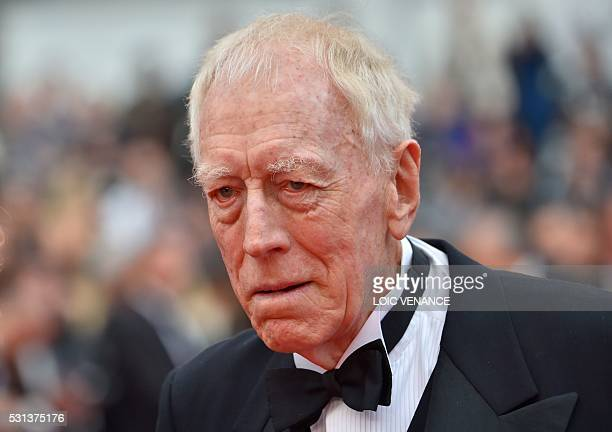 Swedish actor Max von Sydow poses on May 14 2016 as he arrives for the screening of the film The BFG at the 69th Cannes Film Festival in Cannes...