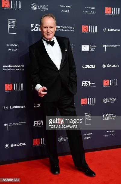 Swedish actor Stellan Skarsgard poses upon arrival for the 30th European Film Awards in Berlin, on December 9, 2017. / AFP PHOTO / Tobias SCHWARZ