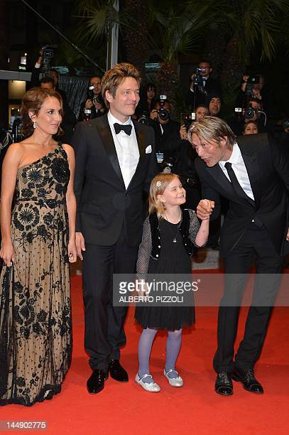 "Swedish actress Alexandra Rapaport , Danish director Thomas Vinterberg , Danish actor Mads Mikkelsen arrive for the screening of ""Jagten"" presented..."