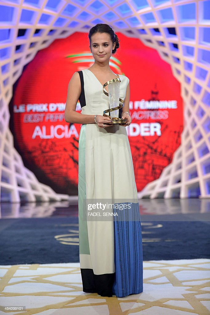 Swedish actress Alicia Vikander holds the prize of the best performance by an actress during the closing ceremony of the 13th Marrakech International Film Festival on December 7, 2013 in Marrakech.
