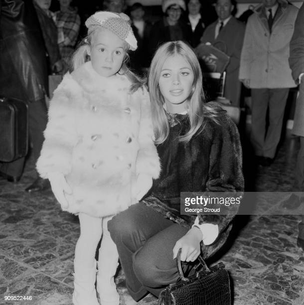 Swedish actress and singer Britt Ekland with her daugher Victoria Sellers at Heathrow Airport 21st December 1968