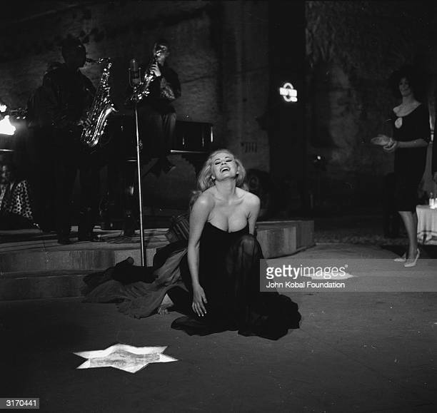 Swedish actress Anita Ekberg enjoys herself at a jazz club in a scene from 'La Dolce Vita' directed by Federico Fellini