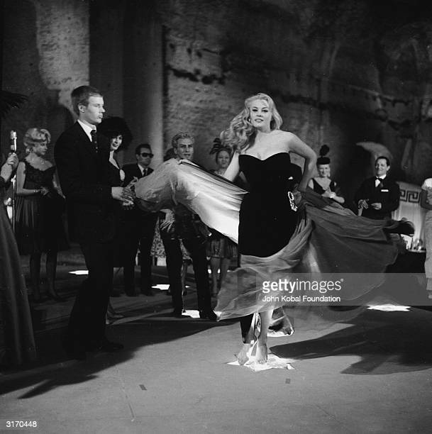 Swedish actress Anita Ekberg gets carried away by the music at a jazz club in a scene from 'La Dolce Vita' directed by Federico Fellini