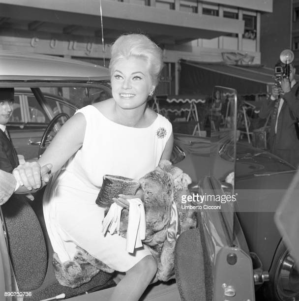 Swedish actress Anita Ekberg gets out of the car to go to a cocktail party for the movie 'Boccaccio '70' Rome 1961 The event is held in the area EUR...