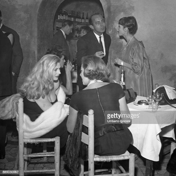 Swedish actress Anita Ekberg is with Gaea Pallavicini Elsa Martinelli and Stanley Franks at the restaurant 'Rugantino' during a dinner party Rome 1958