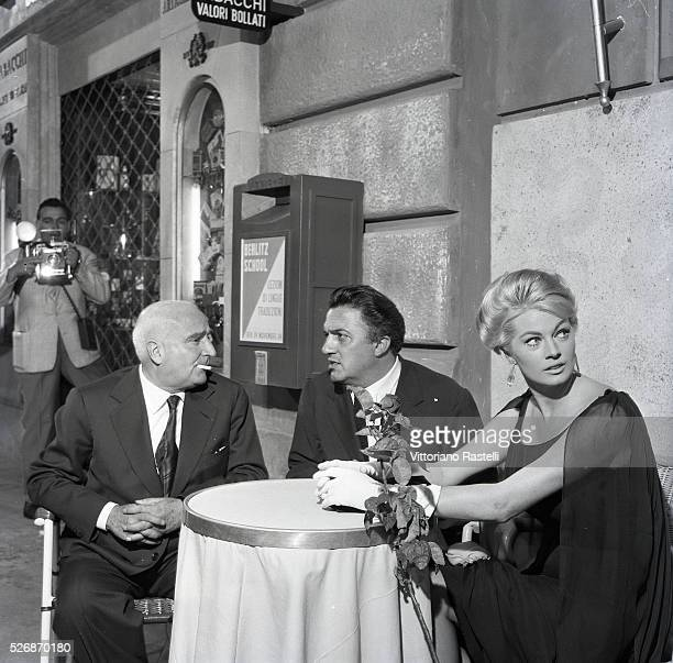 Swedish actress Anita Ekberg Italian producer and publisher Angelo Rizzoli with director and screenwriter Federico Fellini the last day of the set of...