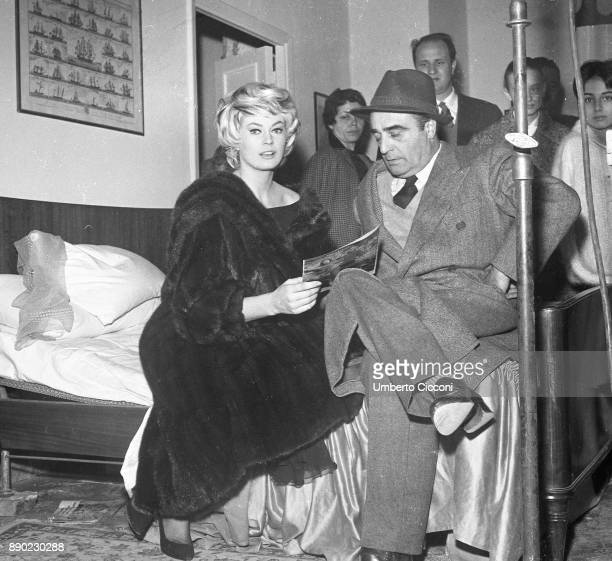 Swedish actress Anita Ekberg with Italian film producer Giuseppe Amato during the shooting of movie 'La Dolce Vita' at the Cinecittà Studios Rome...