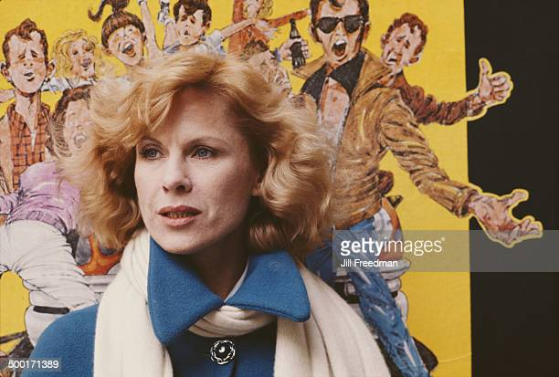 Swedish actress Bibi Andersson in front of a poster for the Broadway musical 'Grease' circa 1980