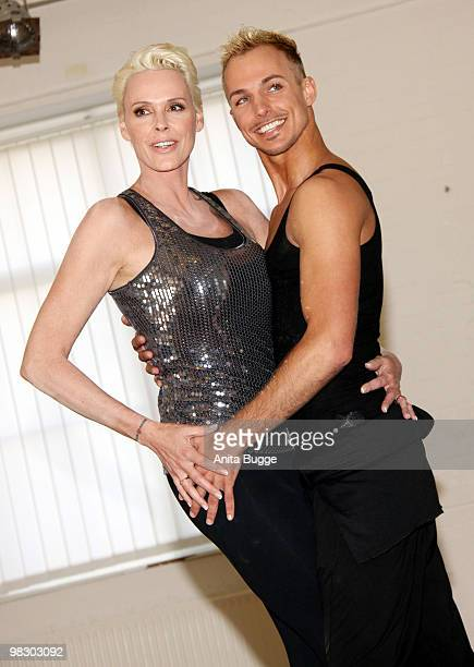 Swedish actress Brigitte Nielsen and dancer Oliver Tienken attend a training lesson for the 'Let's Dance' RTL tv show at Tanzschule Stelter on April...