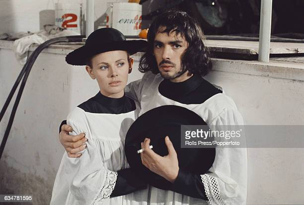 Swedish actress Britt Ekland pictured with French actor Pierre Clementi dressed as priests on the set of the film 'The Year of the Cannibals' in Rome...