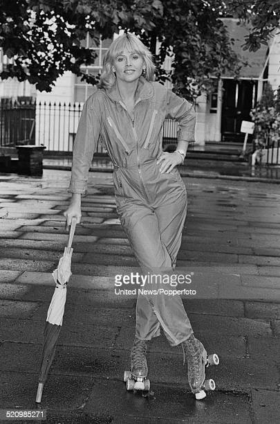Swedish actress Britt Ekland posed wearing a jumpsuit and rollerskates in London on 7th July 1980