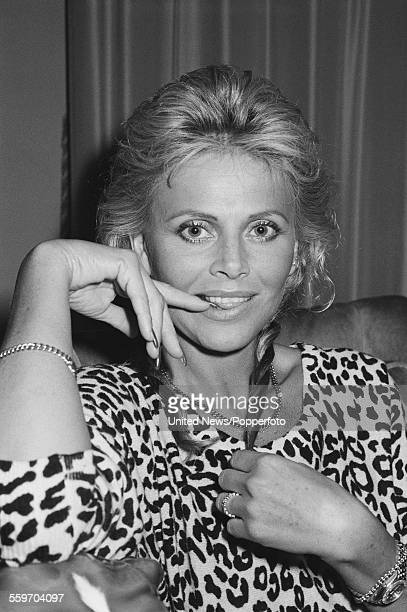 Swedish actress Britt Ekland posed wearing a leopard spot print top at the Waldorf Hotel in London on 6th February 1984