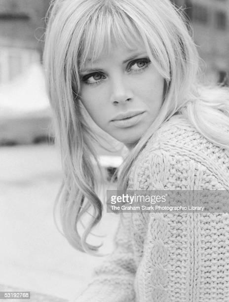 Swedish actress Britt Ekland wearing a cable knit jumper, circa 1965.