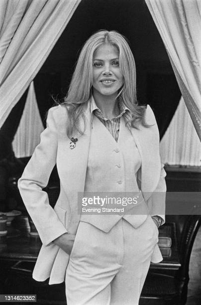Swedish actress Britt Ekland wearing a three piece suit with a panda brooch, UK, 26th March 1974. She appeared in the James Bond film 'The Man with...