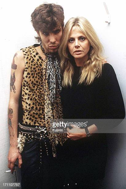 Swedish actress Britt Ekland with her husband Slim Jim Phantom the drummer for American rockabilly band the Stray Cats circa 1990