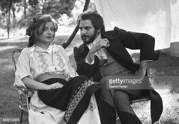 Swedish actress Ewa Aulin and Venezuelan actor Spartaco Santoni talk on the set of the film 'Ceremonia Sangrienta' Madrid Spain 1973