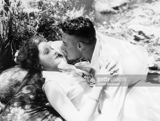 Swedish actress Greta Garbo and American John Gilbert on the set of Love directed by Edmund Goulding