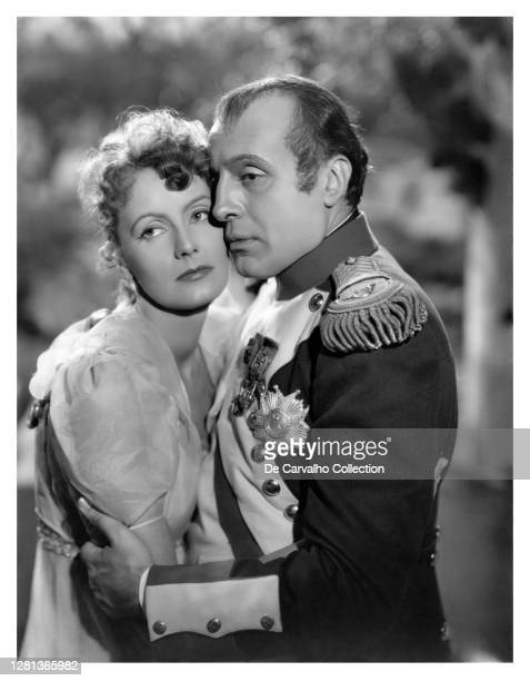 Swedish Actress Greta Garbo as 'Countess Marie Walewska' being embraced by French Actor Charles Boyer as 'Emperor Napoleon Bonaparte' in a scene from...