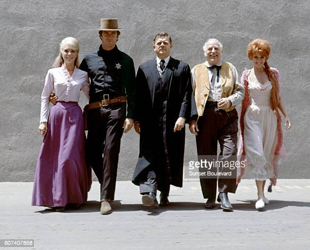 Swedish actress Inger Stevens American actors Clint Eastwood Pat Hingle Ed Begley and Arlene Golonka on the set of Hang 'Em High directed by Ted Post