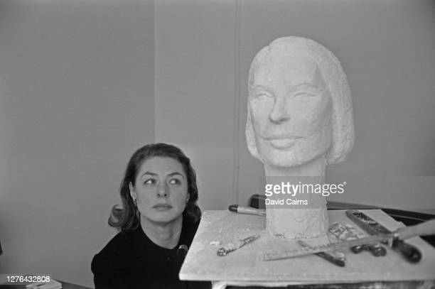 Swedish actress Ingrid Bergman admires a bust of herself by Cypriot sculptor Paulina Paulides, London, 3rd March 1966.