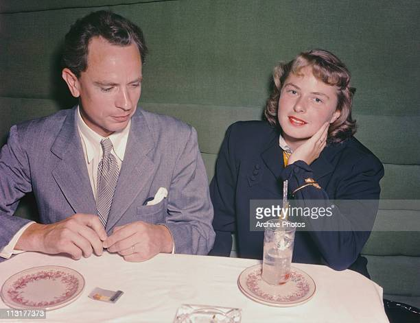 Swedish actress Ingrid Bergman and her husband doctor Petter Lindstrom at a dinner table shortly after their arrival in the United States circa 1940