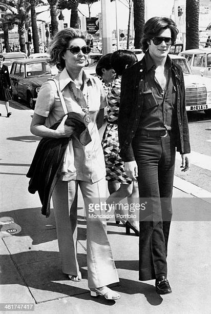 Swedish actress Ingrid Bergman and her son Roberto Rossellini jr walking in a street of Cannes Cannes 1970s