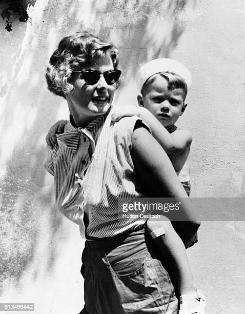 Swedish actress Ingrid Bergman gives her son Robertino Rossellini a piggyback while on holiday in Portofino Italy in 1952