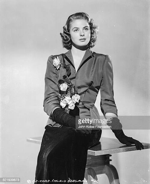 Swedish actress Ingrid Bergman in a promotional shot for Columbia Pictures wearing a black suit and gloves 1941