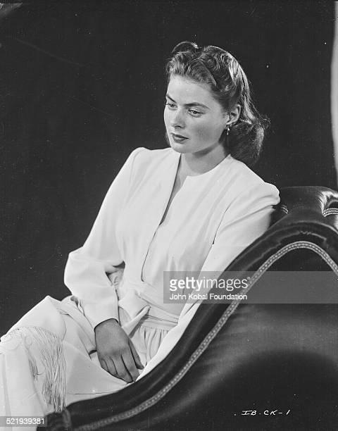 Swedish actress Ingrid Bergman in a promotional shot for Warner Bros Studios wearing a white dress 1942