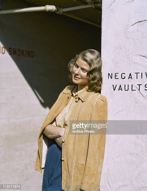 Swedish actress Ingrid Bergman leans against a wall circa 1945