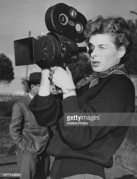 Swedish actress Ingrid Bergman learns how to use a handheld Arriflex camera between takes of the documentary film 'Siamo Donne' at Santa Marinella...
