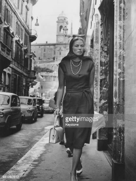 Swedish actress Ingrid Bergman out shopping in the Via Condotti in Rome, Italy, whilst filming 'The Visit', 5th September 1963.