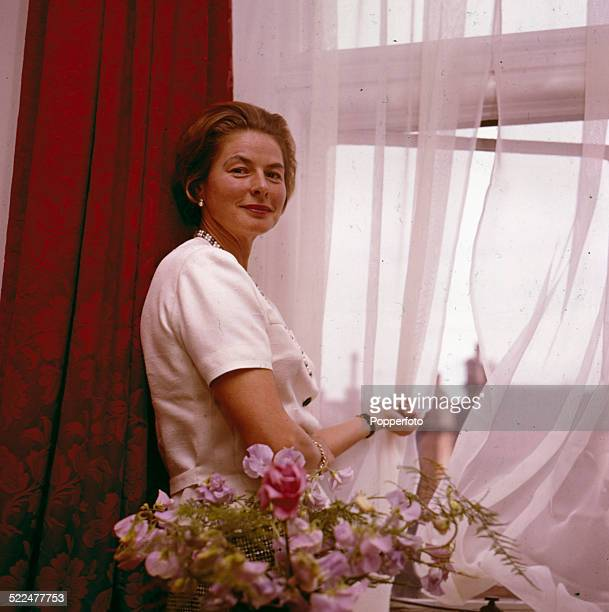 Swedish actress Ingrid Bergman posed at an open window in London in 1964