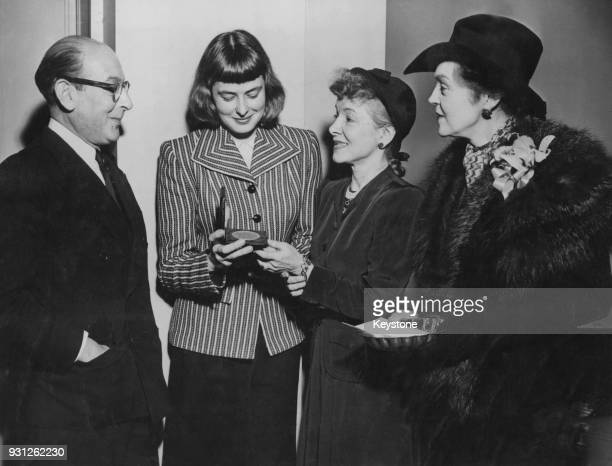 Swedish actress Ingrid Bergman receives the Drama League of New York's annual award for Distinguished Performance for her work in the Maxwell...