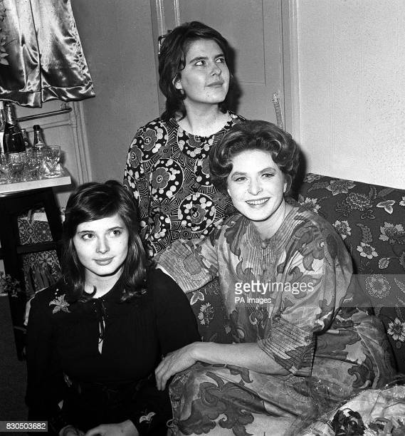 Swedish actress Ingrid Bergman relaxes in the company of her 18 year old twin daughters Isabella and Ingrid Rossellini in her dressing room at the...