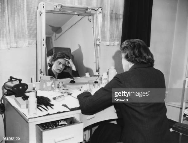 Swedish actress Ingrid Bergman studies the script for her new film 'Indiscreet' in front of the mirror in her dressing room at Elstree Studios, UK,...