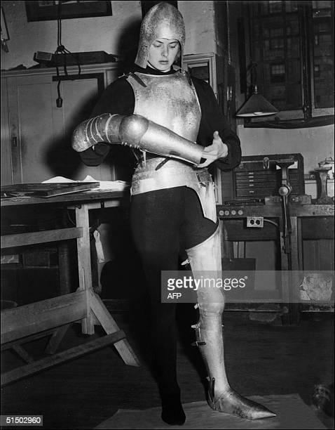 Swedish actress Ingrid Bergman trys the armor that she will wear for her role of Joan of Arc a movie directed by Victor Fleming 09 October 1947 Born...