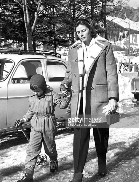 Swedish actress Ingrid Bergman walking hand in hand with her son Robertino Sankt Moritz 1950s