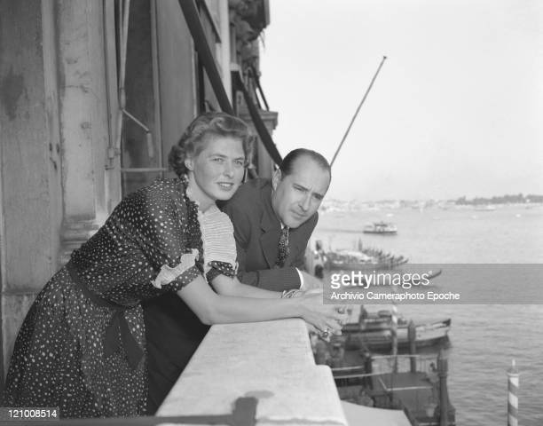 Swedish actress Ingrid Bergman wearing a polkadotted dress portrayed while posing on a terrace with Roberto Rossellini the Canal Grande in the...