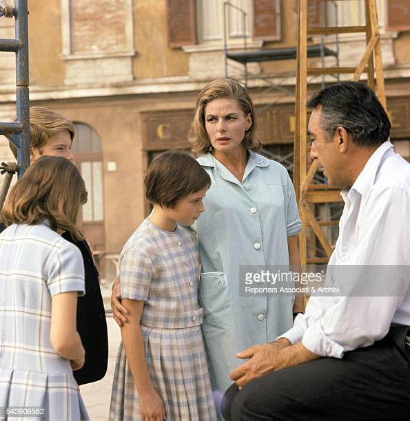 Swedish actress Ingrid Bergman with her children Isotta Ingrid Isabella and Roberto jr Rossellini and MexicanAmerican actor Anthony Quinn on the set...