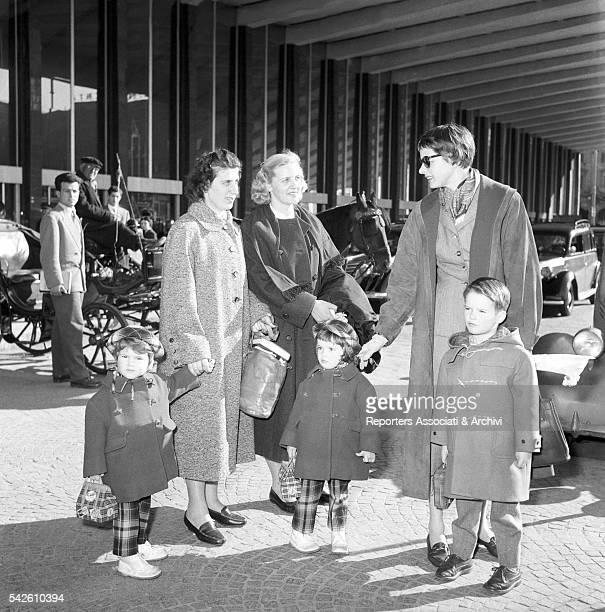 Swedish actress Ingrid Bergman with her children Isotta Ingrid Isabella and Roberto jr Rossellini arriving at Termini station Rome 3rd April 1955