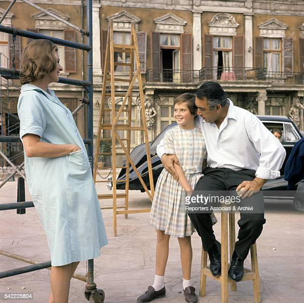 Swedish actress Ingrid Bergman with her daughter Italian actress Isabella Rossellini and MexicanAmerican actor Anthony Quinn on the set of The Visit...