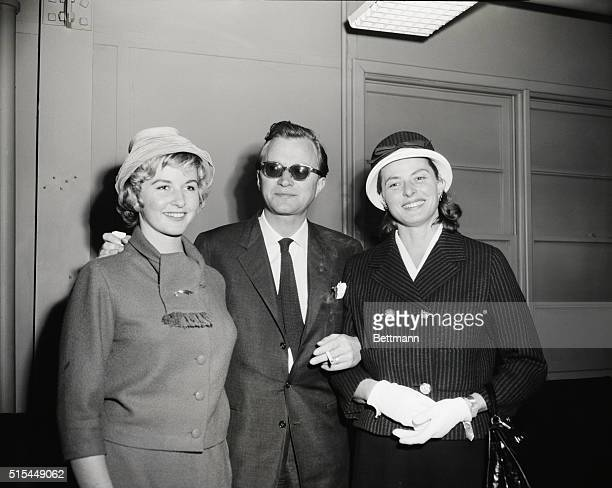Swedish actress Ingrid Bergman with her third husband, Lars Schmidt, and her daughter from her first marriage, Pia Lindström, in the passenger lounge...